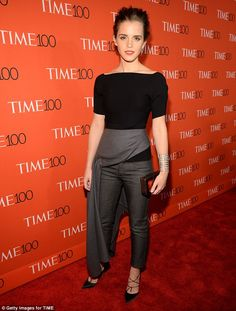 Never a grey day: Emma Watson looked fashion forward in an eccentric outfit as she attende...