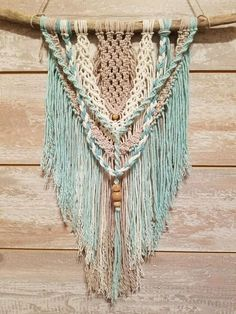 Check out this item in my Etsy shop https://www.etsy.com/listing/578383970/macrame-wall-hanging
