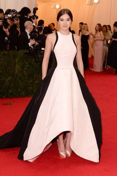 The 21 Best Looks From The Met Ball #refinery29  http://www.refinery29.com/2014/05/67370/met-gala-best-dressed-2014#slide18  How to modernize the standard, poufy red-carpet gown? Easy: Just draw a lean, athletic-chic white dress on top of your standard black-satin stunner. Prabal Gurung's two-in-one felt both age-appropriate for Hailee Steinfeld and more au courant than any other gown. Bravo.