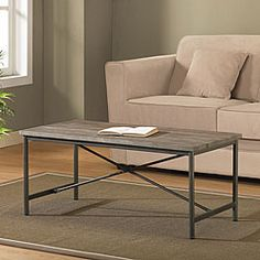 @Overstock.com - Elements Cross-design Grey Coffee Table - Add this rustic grey coffee table to your living room, and make room for entertaining and relaxing. The reclaimed wood surface is naturally distressed, and as no two tables look exactly alike, you can feel confident that you have a unique piece.  http://www.overstock.com/Home-Garden/Elements-Cross-design-Grey-Coffee-Table/5217958/product.html?CID=214117 $149.99