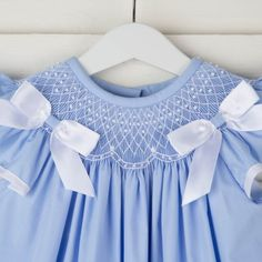 An angel sleeve dress with white geometric smocking. White bows complete the sweet look. Smocked Clothing, Girls Smocked Dresses, Blue Dresses, Smocking Baby, Smocking Patterns, Pretty Little Dress, Little Girl Dresses, Anna Dress, Heirloom Sewing