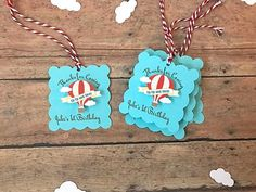 *****Listing is for a set of 12*****  Someones growing up, up, up! Birthdays are so special! And these favor tags are the perfect decoration for your next themed party. Tag features hot air balloon with each picture slightly elevated for a multidimensional look. Each tag is totally customizable to read whatever you would like. Each tag comes strung on 12 of adorable red and white twine. Just be sure to include your choice wording in the notes to seller. Tags are blank on the back to add your…