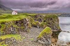 """Arnarstapi (or Stapi) is a small fishing village at the foot of Mt. Stapafell between Hellnar village and Breiðavík farms on the southern side of Snæfellsnes. In Jules Verne's """"A Journey to the Center of the Earth"""", Arnarstapi is the last stop on the route the protagonists take before they climb Snæfellsjökull and enter the interior of the planet though a tunnel in the crater."""
