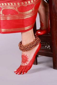 Golden Ghungroo Lambani Anklet Traditionally, the Lambani women folk wear jewelry made out of copper, white metal and silver. Trying to revive the traditional lambani jewelry we have curated a collection of 22 carat gold and silver plated anklets.