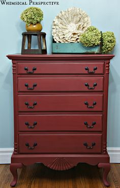 This gorgeous dresser was finished in Primer Red Chalk Paint® decorative paint by Annie Sloan and waxed with Dark Soft Wax | By Laura of Whimsical Perspective