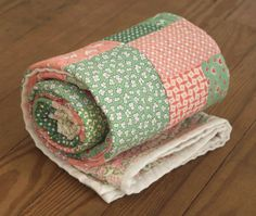 Handmade vintage print lap quilt for your home. Colors include pink, green, and cream. Fabrics are reproduction prints from the Aunt Grace collection.