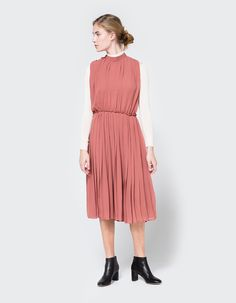 From Farrow, a lightweight dress in Mauve. High-neck collar. Hidden zip closure. Fully lined. Ruched details. Rounded hem.  • 100% polyester • Dry clean only