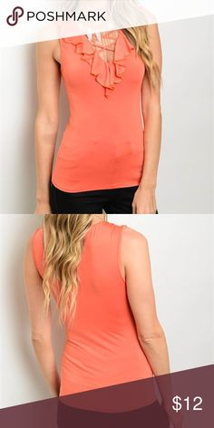 Orange Top Orange Top, super cute. Fits really nice, very comfortable! Molds to your figure. Looks great under a blazer, for an office look. Fabric Content: 95% Polyester 5% Spandex Tops Blouses