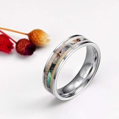 The ring is made of lighter, weightless high-tech titanium than stainless steel and tungsten. The deer antler and camo inlay is the perfect backdrop for the ring, which comes in a choice of 6mm and 8mm. Due to the raw nature of deer antler we can not control the coloring of the antler, so all the rings are unique and there may be some differences in external colors. Tungsten Rings, Titanium Rings, Deer Antlers, Modern Fashion, Lighter, Camo, Coloring, Tech, Wedding Rings