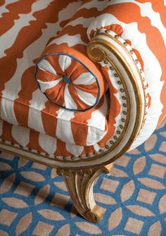 Tangerine Tango upholstered french furniture with peacock blue geometric rug