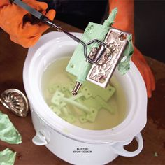 Can't hurt to try... If you want to strip paint from metal without the nasty fumes and mess of chemical strippers, just fill a slow cooker with water and set the dial to high. The heat and moisture will soften the paint, and often it will fall off as a single piece.