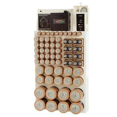 Features:  -Battery storage rack.  -Battery organizer holds up to 82 batteries.  -Slots for D, C, AA, AAA batteries and more.  Color: -Beige.  Product Type: -Wall-Mounted Storage Shelves.  Wall Mounta