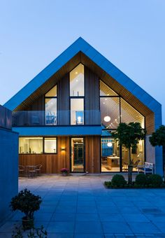 Architectural house facade in Denmark made of wood and metal.