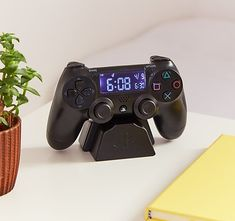 PlayStation Alarm Clock - This is an alarm clock in the design of a PlayStation controller. What a sick gift for gamers, or even just someone who longs for the trill of an authentic alarm clock rather than their iPhone's 'radar'. Playstation, Xbox, Gamer Gifts, Tech Gifts, Ultimate Gaming Room, Cadeau Star Wars, Boy Room, Kids Room, Gamer Bedroom
