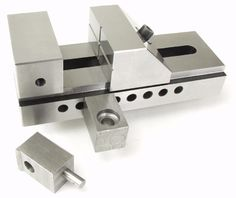 """Screwless Vise Clamps. Screwless Vise Clamps  These blocks provide a quick, easy way to secure a screw less vise to the mill table. The blocks in the picture are next to a 3"""" screw less vise. If you want to make these the size is 1"""" square and 1.5"""" long."""