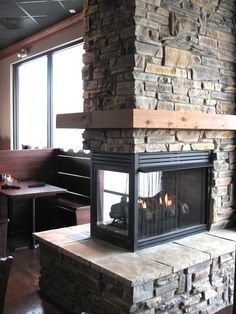 Fireplace, Amusing Living Room With Conventional 3 Sided Fireplace Also Stones Fire Surround Material Also Engaging Floorboard & Wooden Mantelpiece: Delightfully Warm Yourself with Beautiful 2 Sided Fireplace! Ledge Stone Fireplace, Stone Fireplace Pictures, 3 Sided Fireplace, Stone Fireplace Designs, Basement Fireplace, Home Fireplace, Fireplace Remodel, Modern Fireplace, Living Room With Fireplace