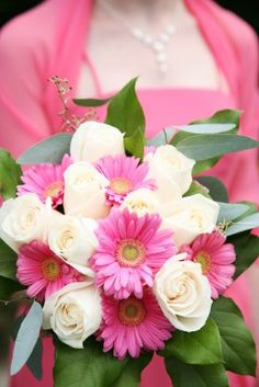Pretty pink gerbera daisy and white rose wedding bouquet. #weddings