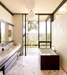 Fabulous view, fabulous bath. Bathroom by Sara Story and Lake|Flato in Hill Country, Texas