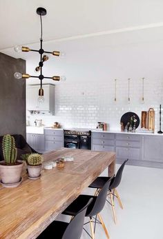 Like a lot of things here: the horizontally laid tiles, the rustic wooden table, the bottom-only kitchen cabinets, contrast between dark grey and white. A little too country for me.