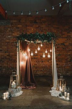 Industrial Chic Wedding Ceremony Arch Ideas A moody industrial wedding ceremony structure with greenery and hanging globe lights. Here are 6 Ideas for your Industrial Wedding Arch from Here Comes The Guide! Chic Wedding, Rustic Wedding, Trendy Wedding, Light Wedding, Wedding With Lights, Elegant Wedding, Lantern Wedding, Dream Wedding, Wedding Updo