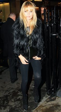2010: Kate Moss wears a beaded camisole, black fur coat, leggings, and black boots