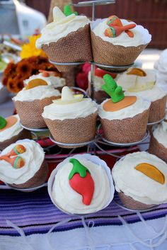 Everything You Need to Host a Festive Cinco de Mayo Fiesta: Dress up your standard sweets with these Edible Fiesta Cupcake Toppers ($26 for 16). Made of vanilla fondant, the toppers are both tasty and cute. Guests will love the variety of sombreros, chili peppers, cacti, tacos, and maracas.