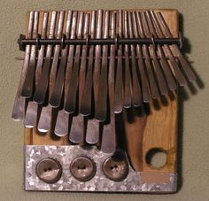 Thumb-piano... uber beautiful sound... aka Mbira, local (Zimbabwe) musical instrument