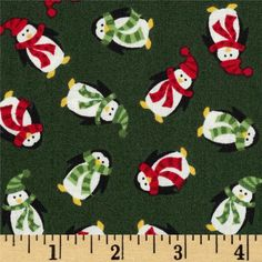 Designed by The Henley Studio for Andover/Makower, this cotton print is perfect for quilting, apparel and home decor accents.  Colors include white, yellow, black, shades of green and shades of red.