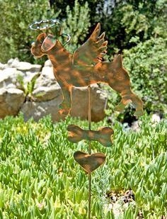 "Boxer dog pet memorial metal copper yard art garden stake by Garden Copper Art is accented with a halo suspended overhead, angel wings, bone, and heart. Available now for purchase. MEASUREMENTS: Please read measurements, thank you! ♥ Stake overall measures approximately 33"" in length, including halo height. ♥ Animal measures approximately 7 1/2 W from nose to the end of rear X 8 H from head to toe.  ITEM DETAILS: ♥ Viewing photos - hover over first photo and click on arrow to see other p..."