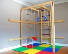 Indoor play gym kids play room. Every boy should have this to help them avoid cabin fever in the winter. More like, every mother of boys should have this!!!