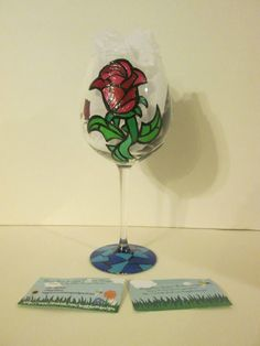 Beauty and the Beast silhouette with stained glass rose on the back and a stained glass design on the bottom. View #2 https://www.facebook.com/buggybeandesigns