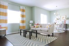 Benjamin Moore's Palladian Blue for the walls. Touches of yellow and raspberry...