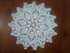 This is a picture of my finished Doily. I got the pattern from www.favcrafts.com/Kitchen-Crochet/Crochet Doily-in-Pineapple Pattern