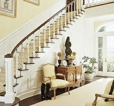 Creamy Yellow Colour Scheme Creates A Warm And Welcoming Atmosphere In This Tastefully Decorated Foyer Pale