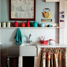 Modern retro mini-kitchen (small space). Notice the use of curtains.