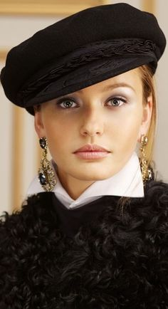 Even the simplest hat upgrades an outfit. I have this hat, except thta mine has two brass buttons on either saide. I love it! ~ETS (ZsaZsa Bellagio)