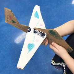 Student's cardboard sculpture of an airplane.