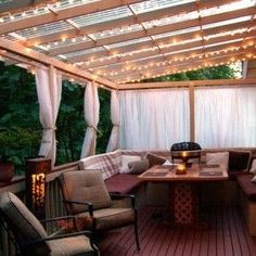 lighting - string lights - summer #porch and #patio decor, design ideas and inspiration Im not in love with the furniture, but I love the space. I had a curtained porch once, made it into a private outside room when they were pulled.