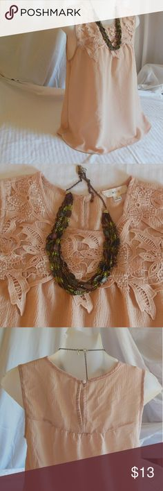 🐱5 for $20🐱 OR Priced as Is. Here I have a gently used camisole or tank top made by Mine in a size small. It is a gorgeous light Peach and color with embroidered lace or perhaps just regular lace work up top. It is obviously pretty lightweight and it is not sheer. Please note that any object photographed with this top are not included. mine Tops Camisoles