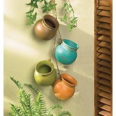 Our southwest aged clay hanging pots will make a charming rustic addition to your interior or patio decor. This item includes 6 clay pots dangling from rope. Southwest Decor, Southwestern Decorating, Southwest Style, Hanging Planters, Planter Pots, Diy Hanging, Hanging Terrarium, Mexican Restaurant Decor, Mexican Wall Decor