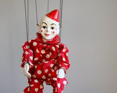 Vintage Clown Marionnette. I have one that looks like this but with a different color suit on.