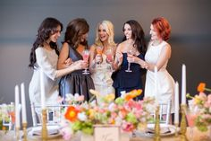 girls toasting at bridal shower brunch with mimosas http://itgirlweddings.com/bridal-boutique-shower/