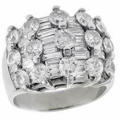 This is a gorgeous diamond 14k white gold ring. The ring is set with sparkling round and baguette cut diamonds that weigh approximately 4.50ct. The color of the diamonds is H-I with VS2 clarity. The tapering width of the ring measures 4mm to 16mm.