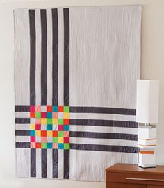 Crossroads: easy modern quilt.  Could also use colored stripes and then the squares would be the color that the two striped colors would be combined on a color wheel.