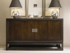 Shop for Century Furniture Credenza, 33H-404, and other Dining Room Cabinets at Granville Interiors in Montgomery, Alabama. Subtleties in Detail. From clipped corner detailing and slight reveals to carved diamond faceted framing, shadow box molding that envelops the case to soft hammered silver hardware accents and carved saber legs with eight facets, there is subtle complexity in every piece of Tribeca which reveals itself in degrees the longer you gaze.