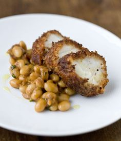 In this monkfish recipe, chorizo adds fantastic character to the monkfish tail. Spiced beans are served alongside the chorizo-crusted monkfish in this dish. Tapas, Seafood Recipes, Cooking Recipes, Healthy Recipes, Spicy Recipes, Monkfish Recipes, Food And Travel Magazine, How To Cook Chorizo, Great British Chefs
