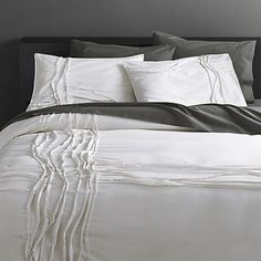 Woven of soft cotton/linen, flowing ribbons of fabric cross paths off-center in an organic ripple effect. Duvet reverses to solid white. Duvet has non-slip corner ties and hidden button closure. Modern Duvet Covers, White Duvet Covers, Duvet Cover Sets, White Bedding, Linen Bedding, Bed Linens, White Linens, Neutral Bedding, Bedding Shop