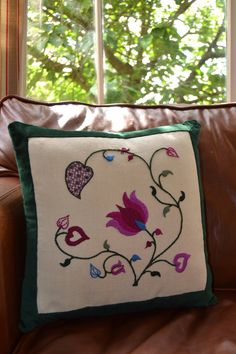 A beautiful hand embroidered crewelwork cushion in Summer colours of fushia pink and cornflower blue, designed and embroidered by a Royal School of Needlework trained hand embroiderer. This cushion has been designed to complement by crewelwork lampshades and crewelwork lampshade kits (all available in my shop). This embroidery is worked on natural coloured linen twill and backed and bordered with a cotton velvet in a luxurious deep forest green shade. A zip has been added for convenience…