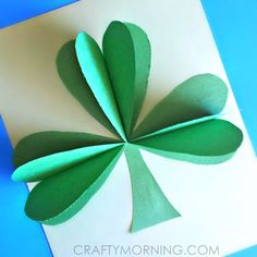 Learn how to make a 3D shamrock out of paper and glue! This is a fun and easy St. Patrick's day craft for kids to make. Perfect for homemade DIY cards.