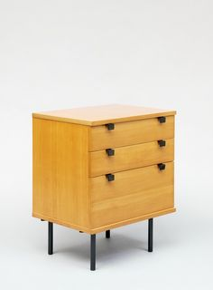Alain Richard; #219 Elm and Enameled Metal Chest of Drawers for Meubles TV, c1955.